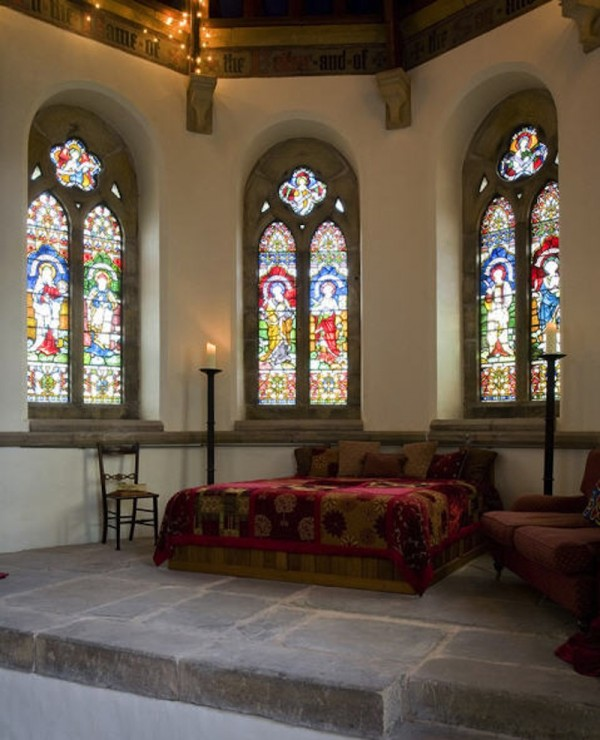 But here is the main bedroom, with a hand built super-king size bed replacing the altar, backed by eight beautiful stained glass panels. Can you imagine sleeping in the apse?!