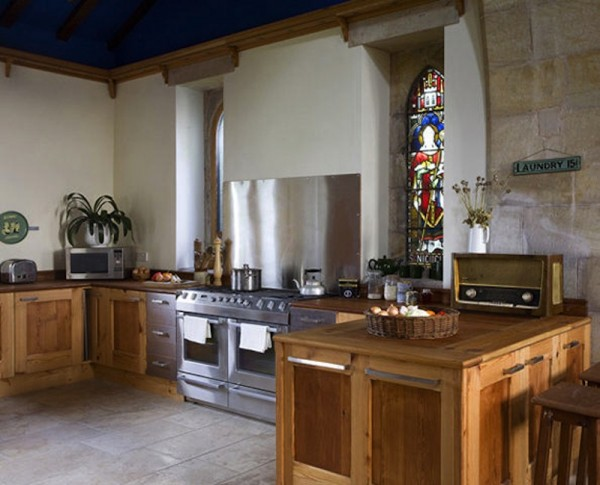 Just take a look at this awesome family kitchen, built from pitch-pine reclaimed from old church pews and roof timbers. It also has underfloor heating and a log burning stove as well.