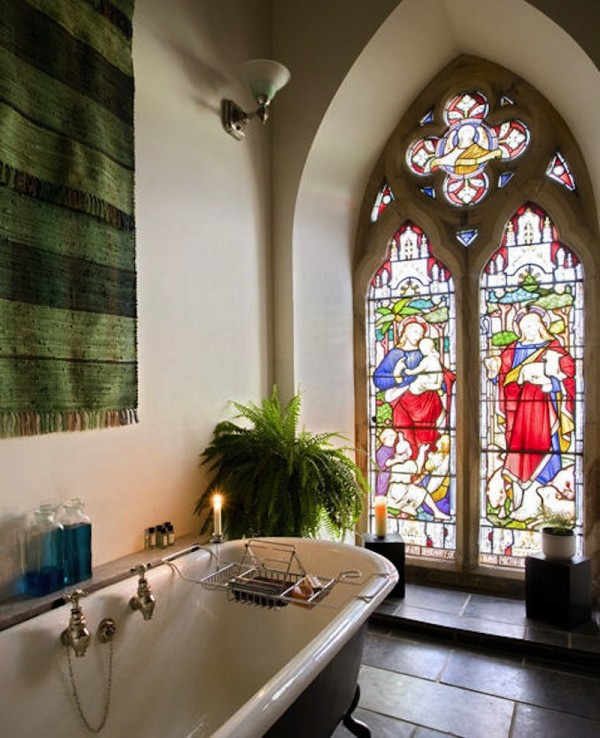The French bathroom is split over three levels, featuring stunning stained glass windows so guests can enjoy the views from the tub.